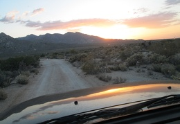 A dirt road takes me into the sunset and to a campsite
