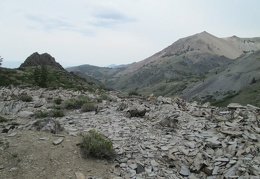 I hike past a rock turret and shale pile
