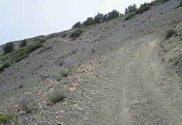 The road rises via a switchback and then passes this off-camber area