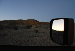 I drive past Owl Hole Spring at dusk, certain that a burro nearby is watching me again