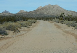 At this point, Excelsior Mine Road is headed straight for the Mesquite Moutnains