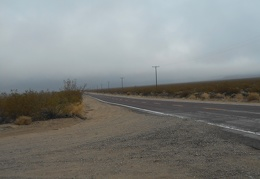 At the junction of Kelso Dunes Road, a glance down Kelbaker Rd toward Kelso reveals little