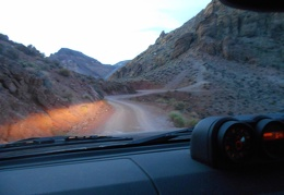 Headlights on, the best part of the Titus Canyon drive ahead will be in the dark