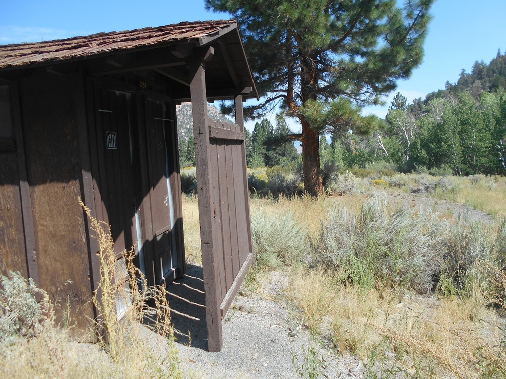 The outhouse has both a men's and women's side