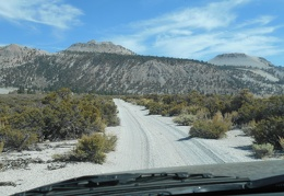 This sandy road seems to lead up into the foothills of the Crater Mountain area