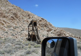 I drive slowly past an old mining installation