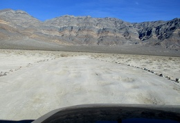 Just beyond Eureka Dunes, the road is pocked with deep, dried mud puddles