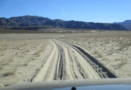 I drive on past Eureka Dunes on Steel Pass Road through a sandy area