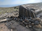 Piled rock protects the base of the cabin from the wind