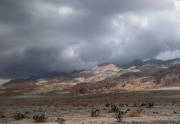 I reach North Highway while sun and clouds play over the Grapevine Mountains